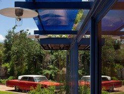 A polycarbonate awning provides heat and glare protection while still allowing plenty of light to pass inside.