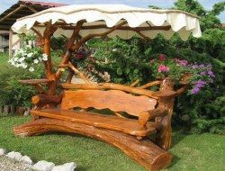 This bench ticks a lot of boxes. It's got a cover to keep you cool AND a place to keep your drink!