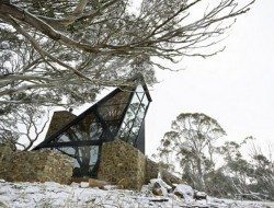 The home looks as though it grew along with the snow gums.
