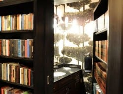 Have you ever wanted to REALLY get away from the kids? Will this bathroom hidden behind a bookcase help?  Thumbs up?