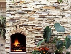 Another clever design using the dry stone building technique - this time incorporating a cozy outdoor fireplace into the garden wall.