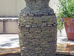 Wondering how you can make use of dry stone wall techniques?  Why not try building a water feature like this?