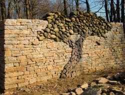In the spirit of the dry stone firepit we showed you earlier, here is a stunning dry stone wall, designed and built by Eric Landman. This wall is built in a conservation area in Orangeville, Ontario, as a memorial to his late wife Kerry Landman.  Love it or loathe it? Would you ever attempt a project as complicated as this?