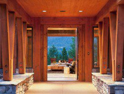 Warm timbers line the extended portico that leads guests to the home's entry