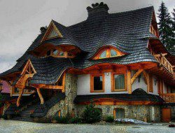 I don't know about you but this wonderful roof immediately evokes remembrances of fairy-tales. The home is in Zakopane Poland.