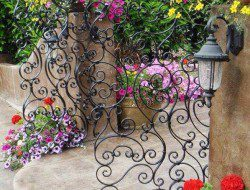 We all like a nice entry but doesn't that really start at your front gate? We say this one is both beautiful and functional.