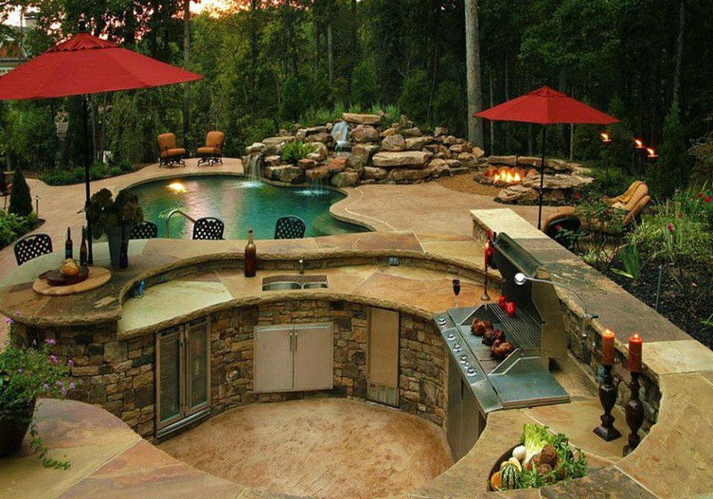 It's got a pool, a water feature, a fire pit, an outdoor kitchen, a big outdoor entertaining area and a view. What else do you think is missing?
