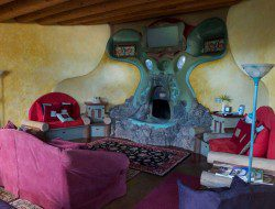 This fireplace is in an earthship living room.  What do you think of it?