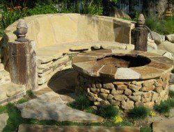 Soooo loving this! Dry stone wall, meets fire pit, meets outdoor furniture.