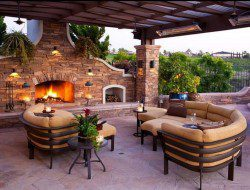 We love the comfy seating and the open fire in this outdoor space. How about you? What features would you add or remove?