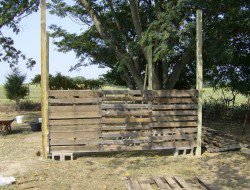 How To Build A DIY Pallet Shed -  Attaching pallets