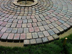 DIY Patio with Fire Pit - Ensuring Pavers are Well Spaced.