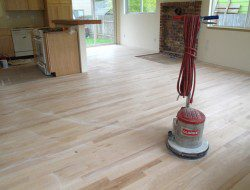 DIY Reclaimed Wood Flooring - Sanded and sealer coating