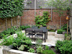 Courtyard with dining area and raised bed planters.