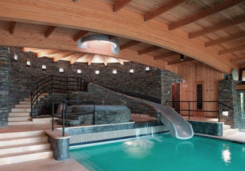 Indoor Pool Design with Cool Slide and Wooden Ceiling - Remals
