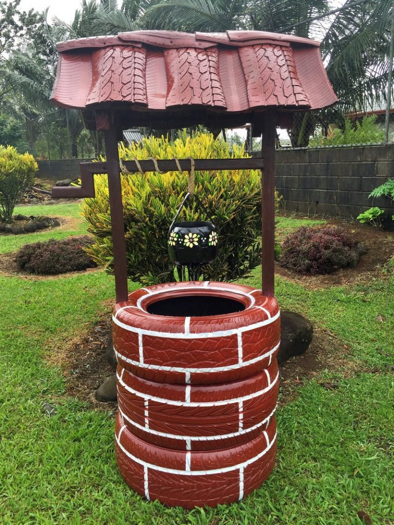 Wishing well planter made from recycled tires