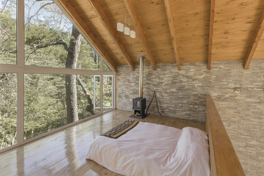 Two bedrooms provide stunning views of the outdoors.