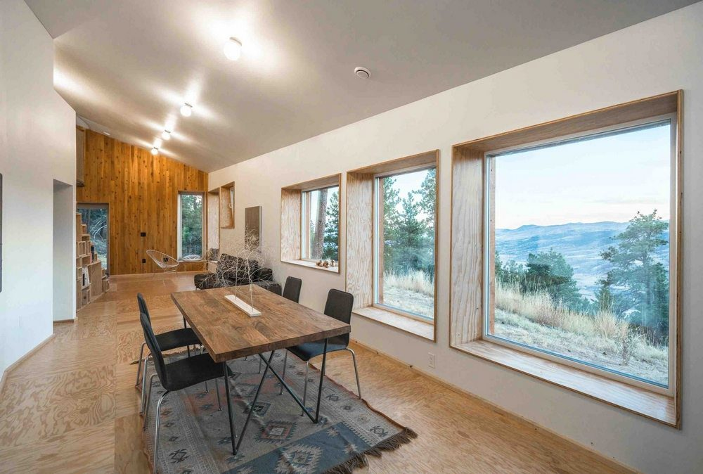 Large windows offer stunning views of the surrounding landscape.