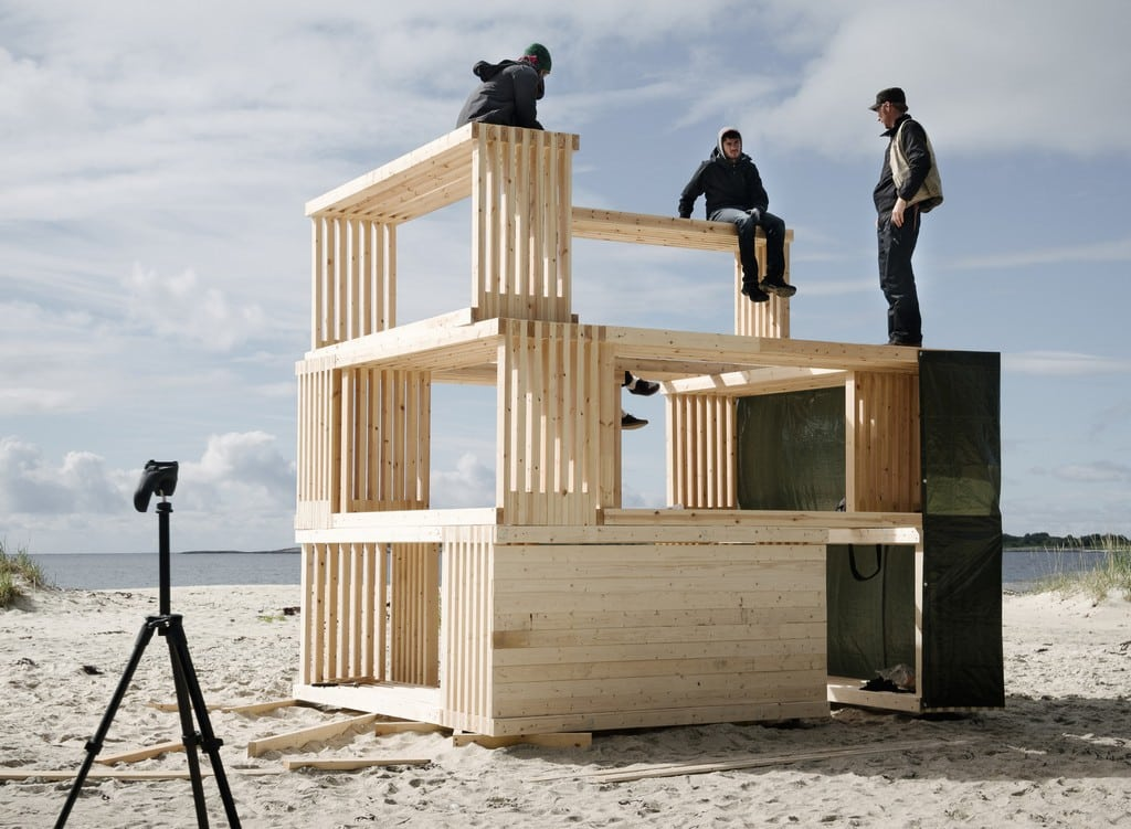 Timber boxes are stacked on top of each other to form one habitable Nomadic Shelter unit.
