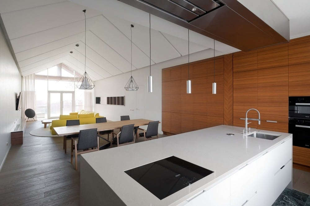 High ceilings and neutral color tones make the interiors bigger and brighter.