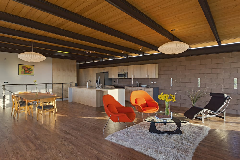 The open plan layout allows seamless movement between the dining, living, and kitchen areas.