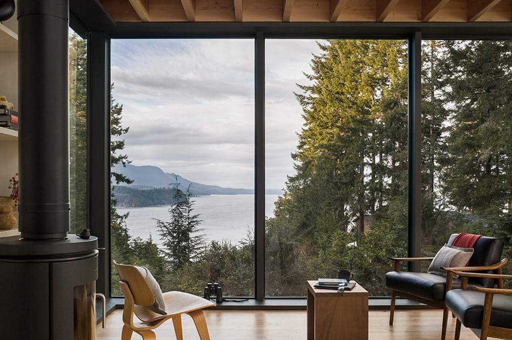 The living areas of the Little House offer stunning views of the tall trees and glistening waters.