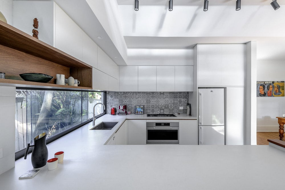 White walls and neutral color tones dominate the interior spaces.