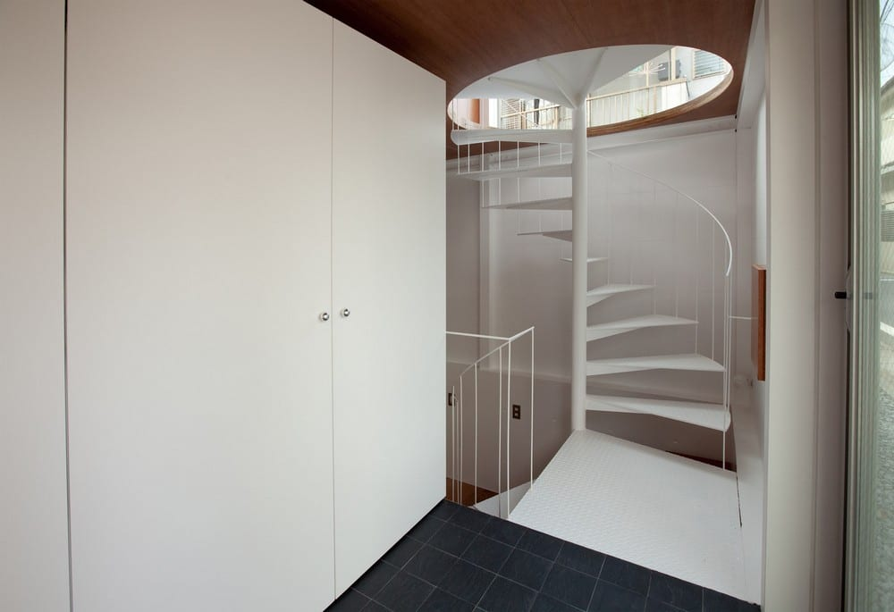 Like most houses, Small House offers an interesting focal point - this white spiral staircase.