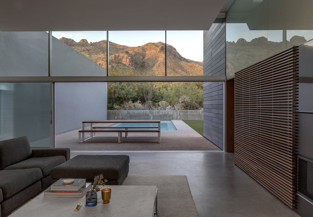 Large windows provide unrestricted views of the surrounding landscape.